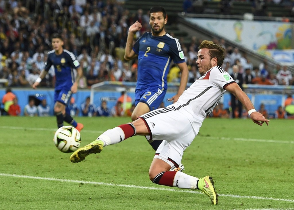 Germany's Mario Goetze scoring in the 113rd minute. REUTERS/Dylan Martinez
