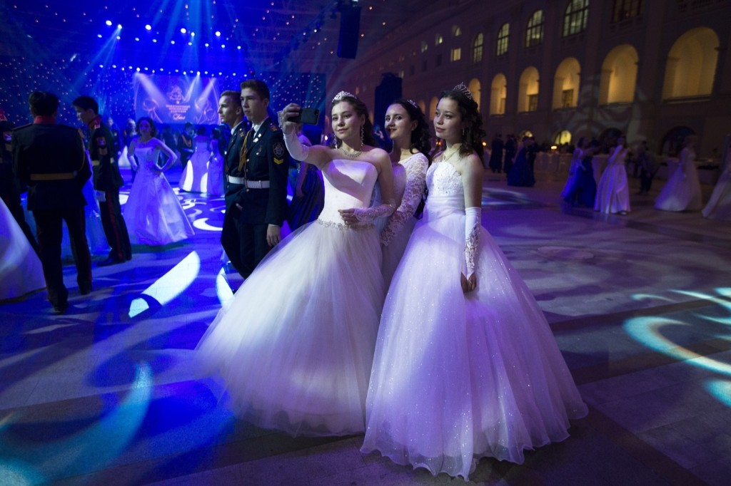 Military school students take selfies during their annual ball in Moscow. AP Photo/Alexander Zemlianichenko