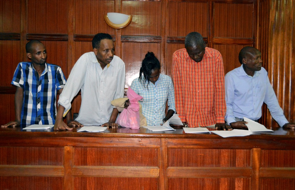 Suspects (L-R) Osman Ibrahim, Oliver Muthee, Gladys Kaari, Guled Abdihakim and Joel Nganga stand in the dock inside the Mililani Law Courts where they appeared in connection with the attack at the DusitD2 complex, in Nairobi, Kenya January 18, 2019. REUTERS/Stringer