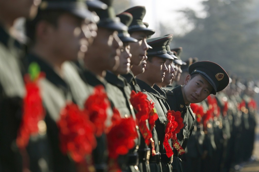 A People's Liberation Army veteran looks out as he and other soldiers attend a farewell ceremony at a military base in Hangzhou. REUTERS/William Hong
