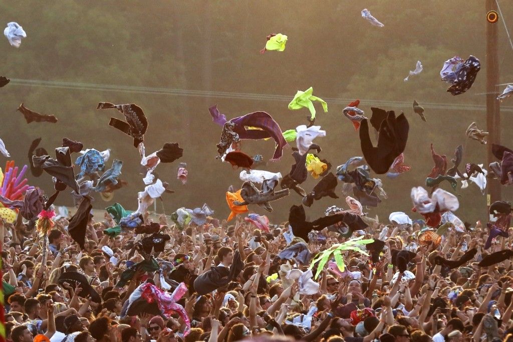 Festival goers throw their t-shirts in the air during a performance by Major Lazer at Bestival on the Isle of Wight. Jim Ross/Invision/AP Images