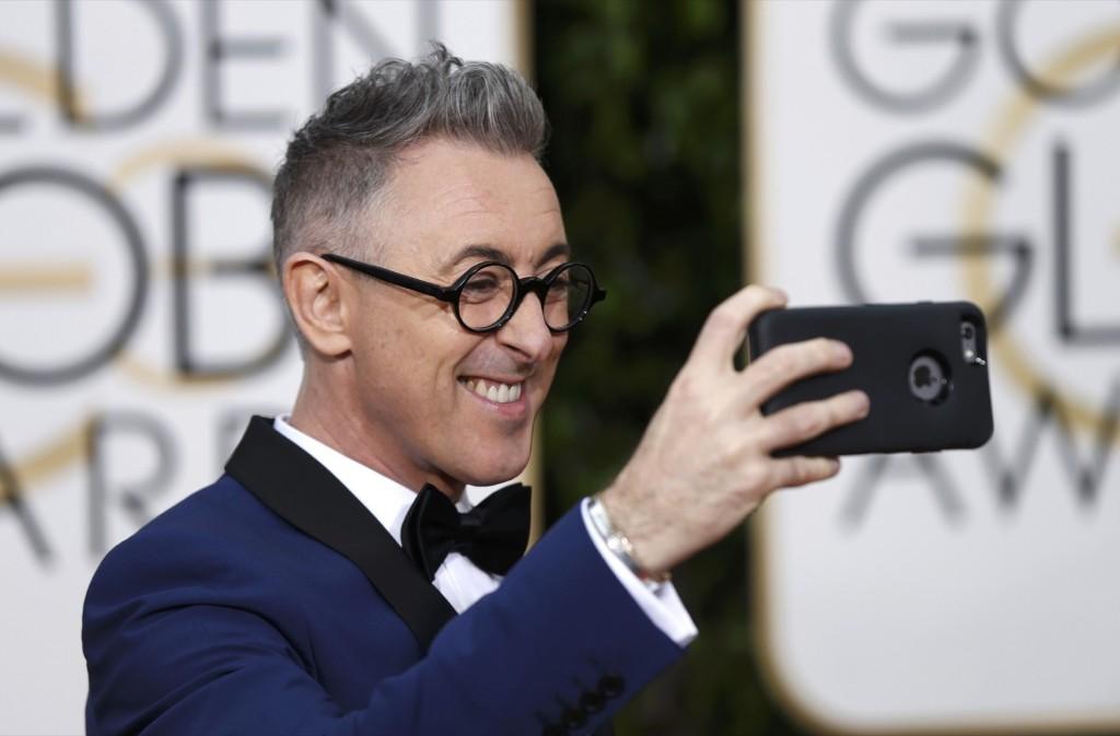 Alan Cumming arrives at the 73rd Golden Globe Awards. REUTERS/Mario Anzuoni