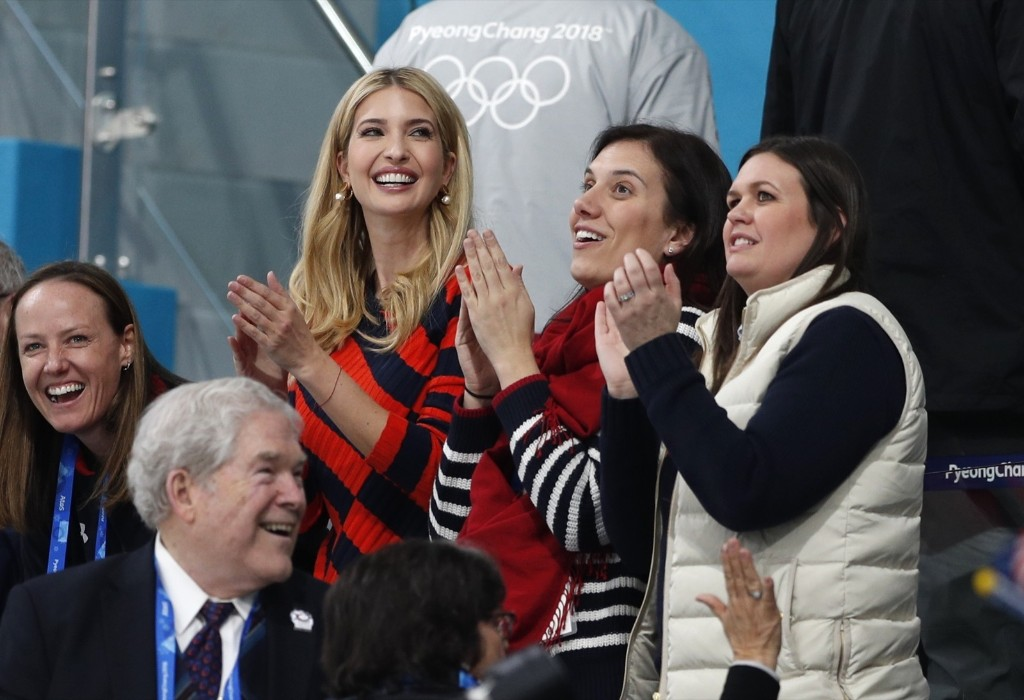 Ivanka Trump and White House Press Secretary Sarah Huckabee Sanders applaud during the men's gold medal curling final won by the U.S. REUTERS/John Sibley
