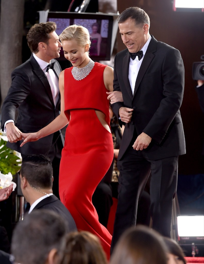 Jennifer Lawrence and David O. Russell arrive at the Golden Globes. Jordan Strauss/Invision/AP