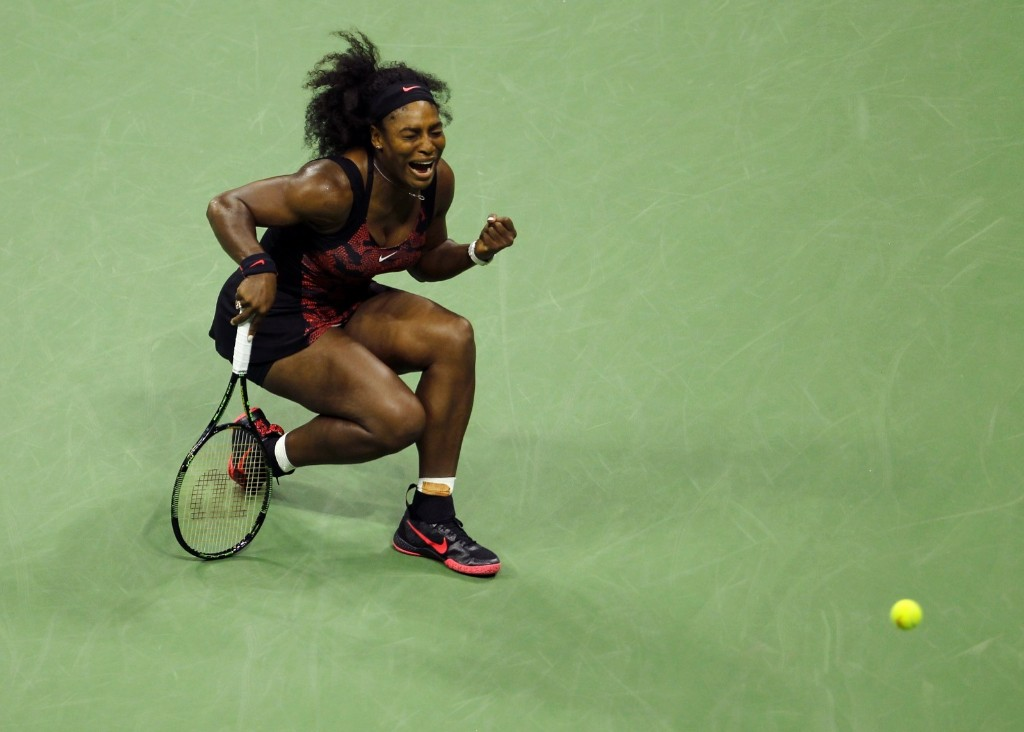 Serena Williams of the U.S. celebrates the second last point before defeating her sister Venus Williams at the U.S. Open tennis tournament in New York, Tuesday. Gary Hershorn/Corbis