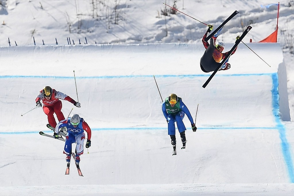 Canada's Christopher Delbosco (R) falls as France's Francois Place (2nd L) leads in a men's ski cross heat. LOIC VENANCE/AFP/Getty Images