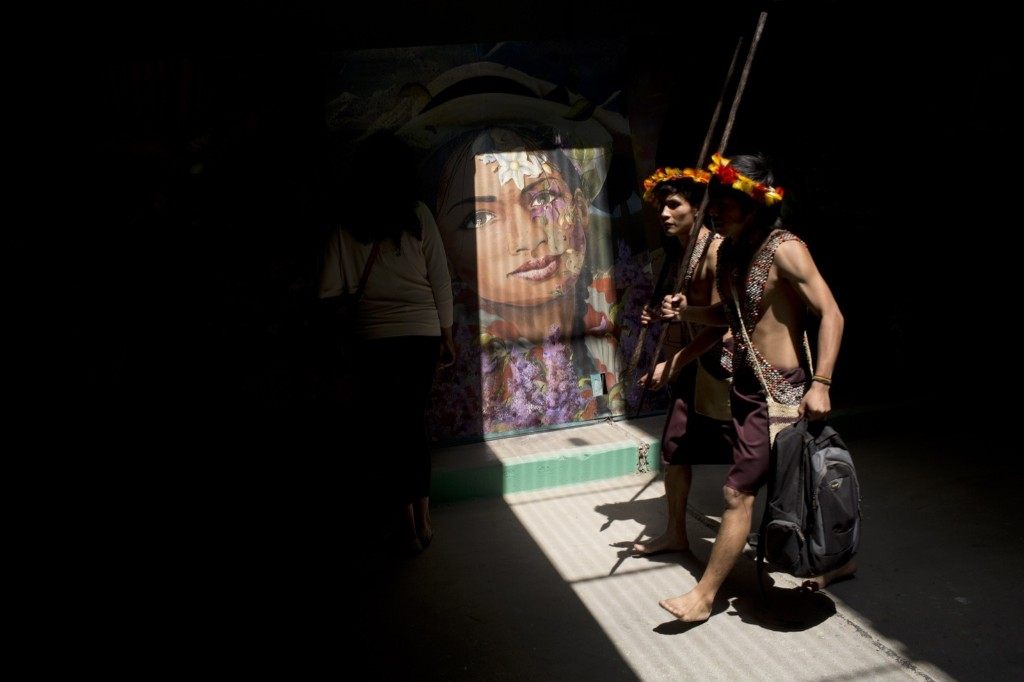 Indians walk though a tunnel decorated with murals during the Climate Change Conference in Lima, Peru. AP Photo/Rodrigo Abd