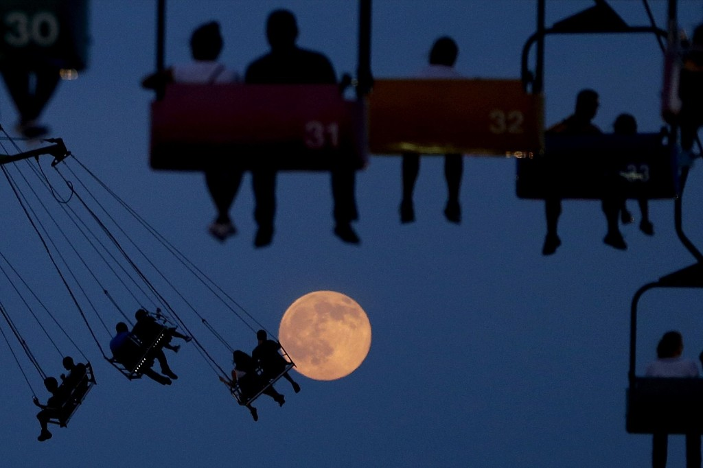 The moon rises at the State Fair Meadowlands in East Rutherford, N.J. AP Photo/Julio Cortez