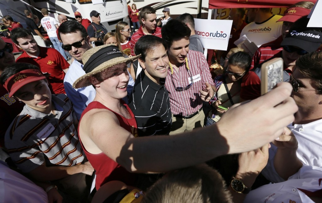 Marco Rubio with students during a tailgate party in Ames, Iowa. AP Photo/Charlie Neibergall