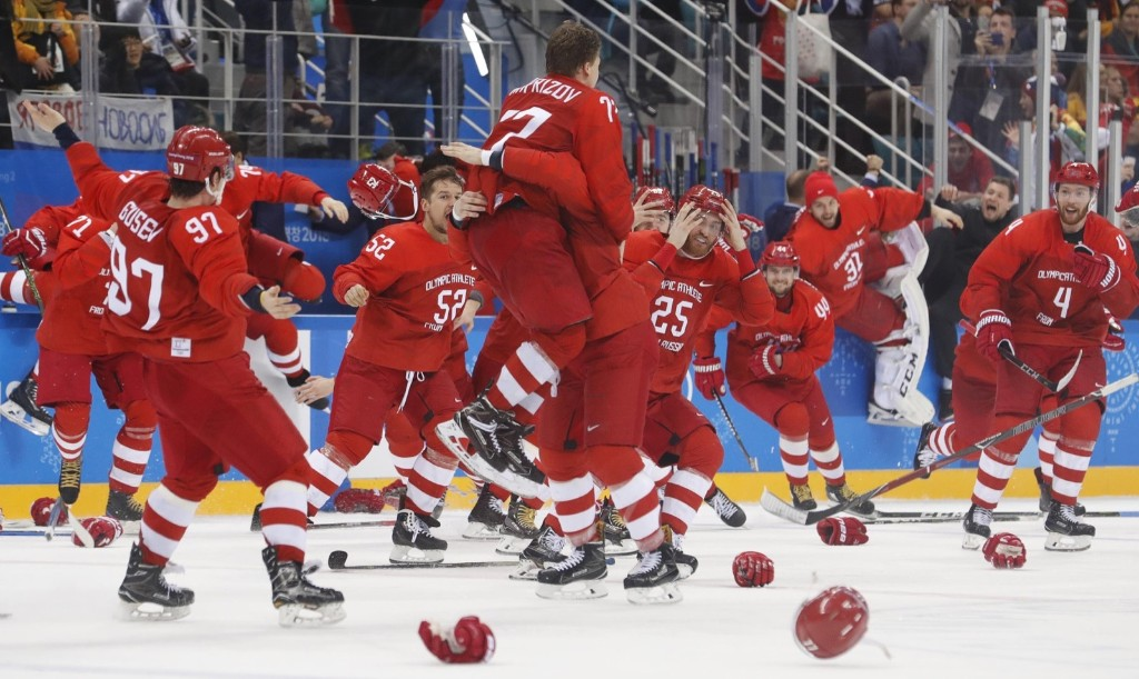 Olympic Athletes from Russia celebrate after defeating Germany in overtime to win the gold medal in hockey. REUTERS/Kim Kyung-Hoon
