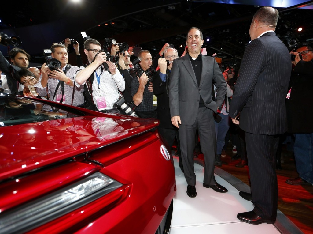 Comedian Jerry Seinfeld and Acura General Manager Mike Accavitti next to a 2015 Acura NSX at the North American International Auto Show in Detroit, Monday. REUTERS/Mark Blinch