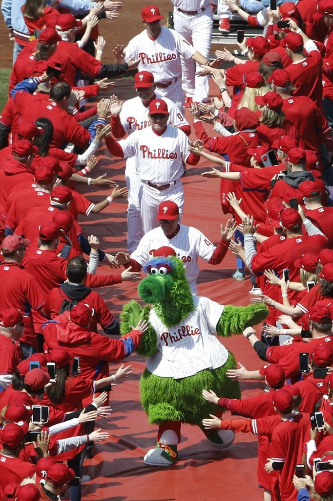 Fans greet the Philadelphia Phillies and their mascot, the Phillie Phanatic, ahead of a home opening day baseball game against the San Diego Padres. AP Photo/Matt Rourke