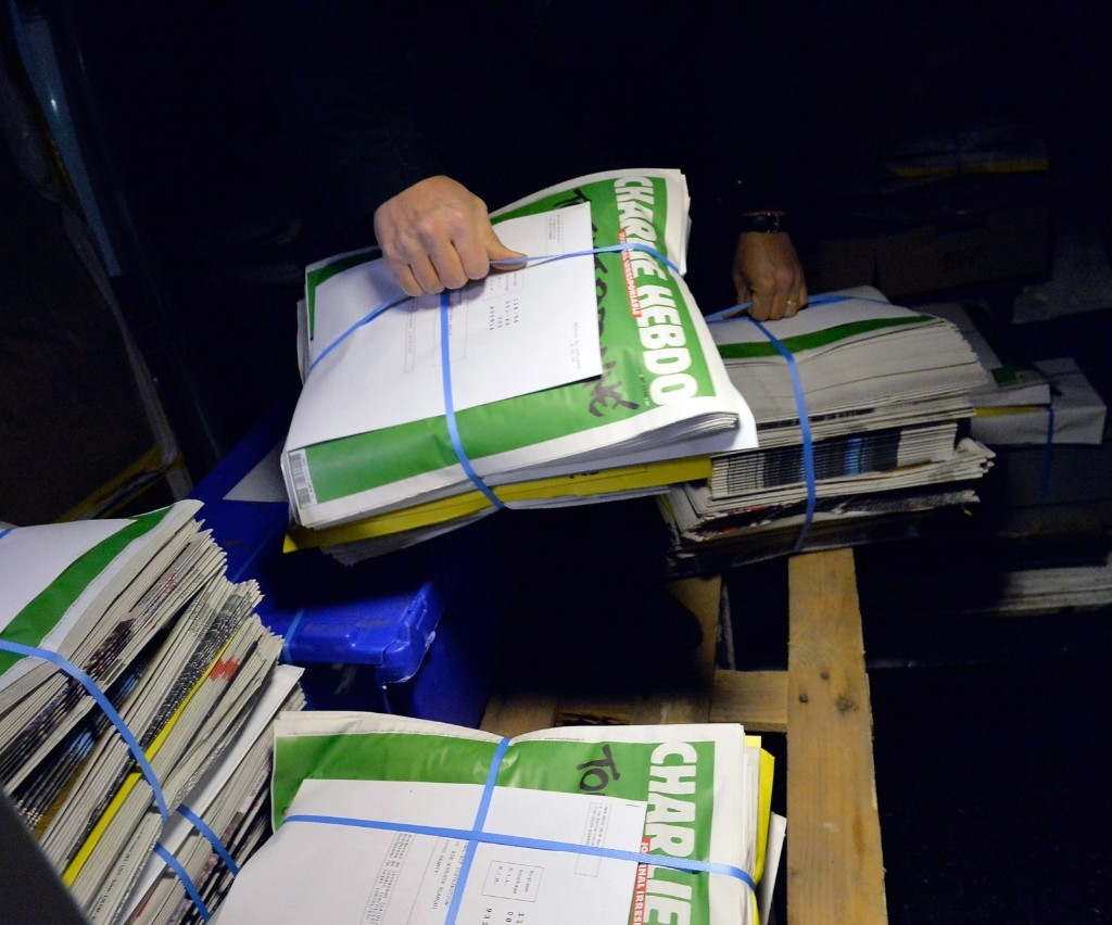 The latest edition of Charlie Hebdo is prepared for delivery at a press distribution center in Paris, Wednesday. Aurelien Meunier/Getty Images