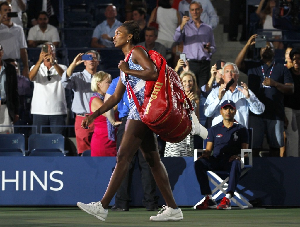 Venus Williams of the U.S. arrives for her match against her sister Serena Williams at the U.S. Open tennis tournament in New York, Tuesday. Gary Hershorn/Corbis