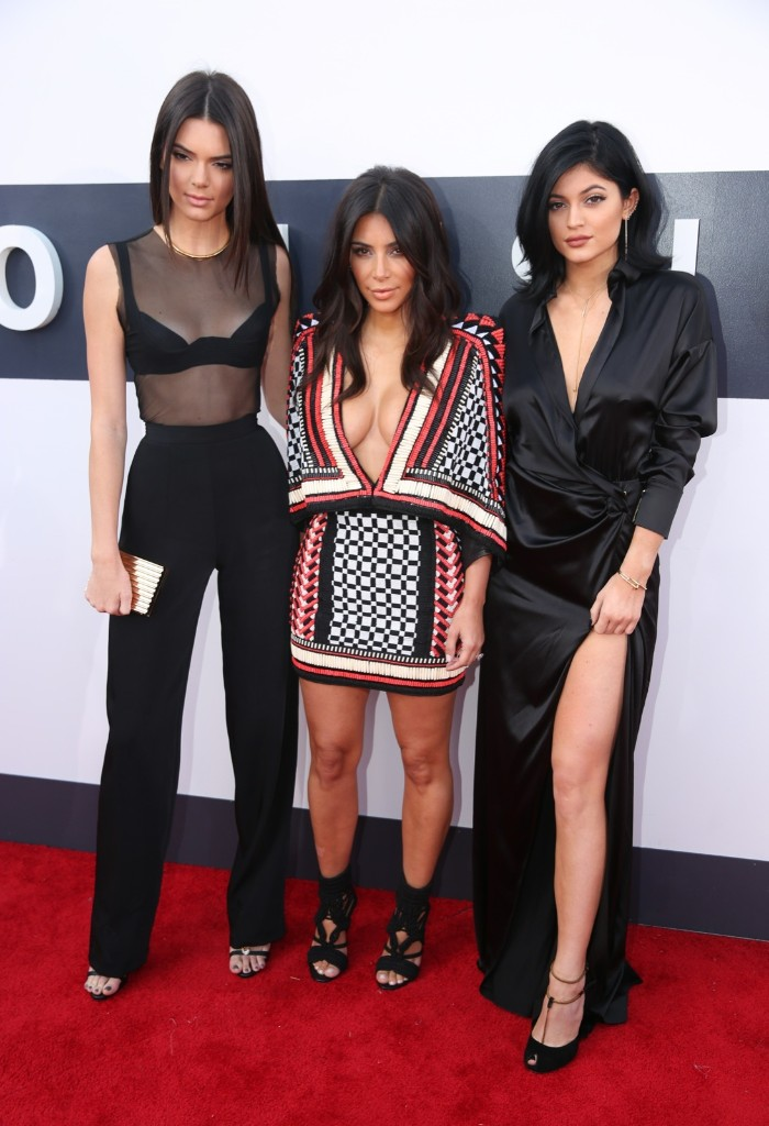Kim Kardashian arrives with her sisters Kendall Jenner and Kylie Jenner. Photo by Matt Sayles/Invision/AP
