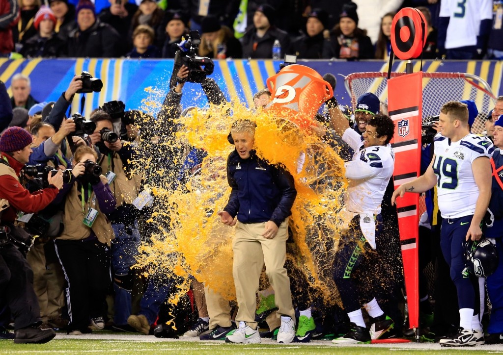 Coach Pete Carroll getting Gatorade bath after routing Broncos, 43-8, in Super Bowl XLVIII last Feb. in East Rutherford, NJ. Rob Carr/Getty Images