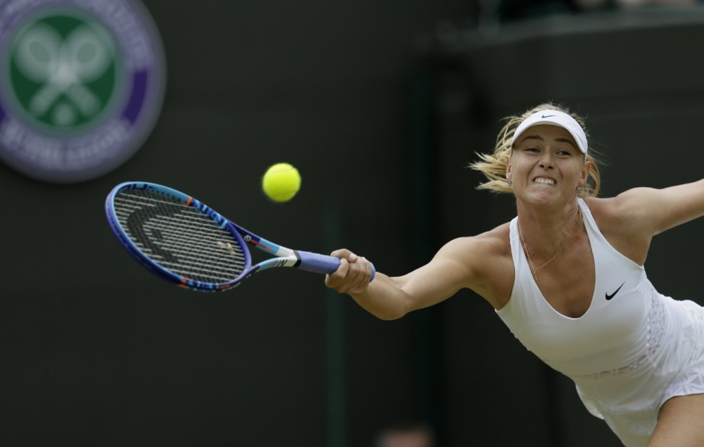 Maria Sharapova makes a return to Zarina Diyas of Kazakhstan. AP Photo/Tim Ireland