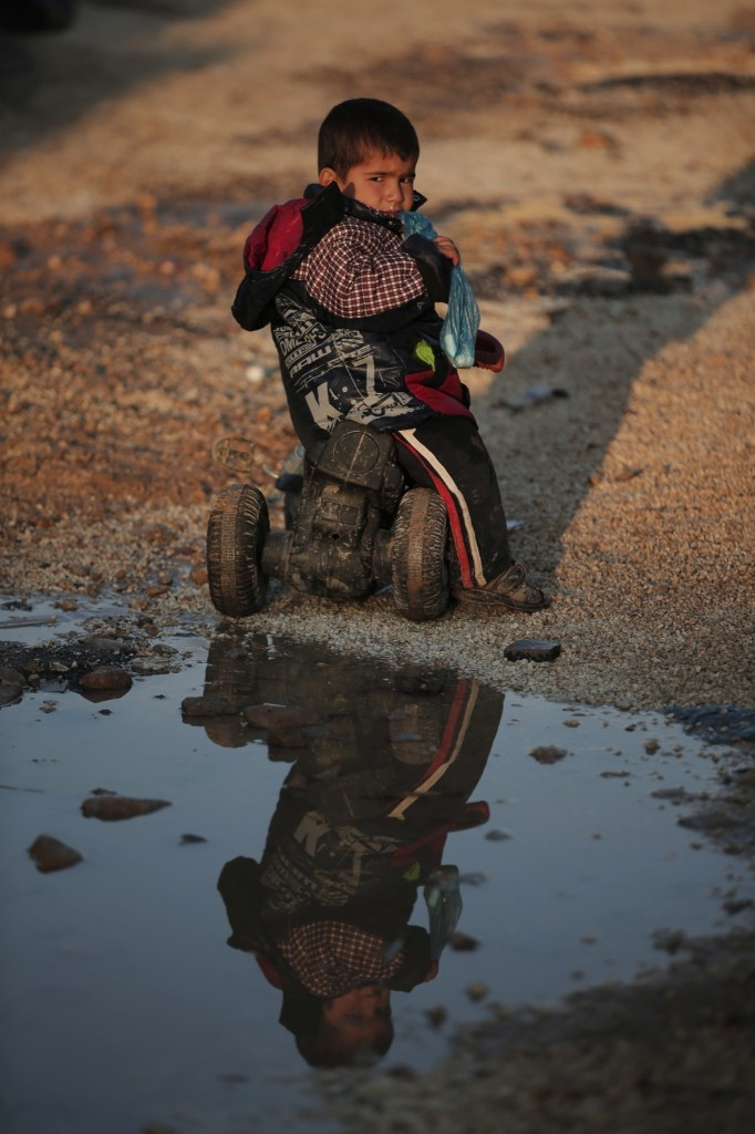A Syrian Kurdish refugee boy, who fled fighting in Kobani, at a refugee camp in Suruc. AP Photo/Lefteris Pitarakis