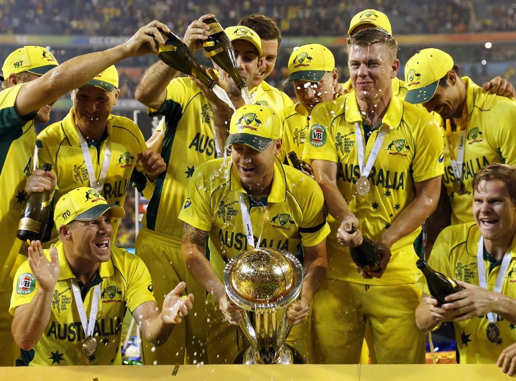 Australia's captain Michael Clarke holds the Cricket World Cup trophy as he celebrates with teammates after they defeated New Zealand in the final, in Melbourne, Sunday. REUTERS/Jason Reed