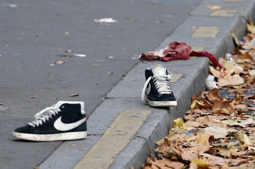 Shoes and a shirt lay outside the Bataclan concert hall. AP Photo/Christophe Ena
