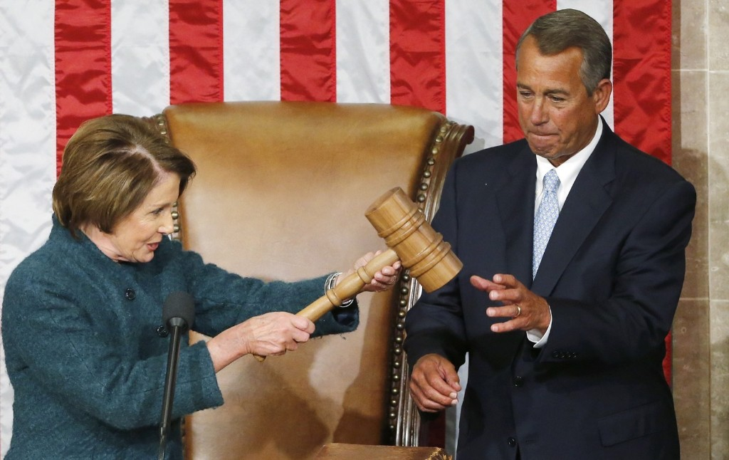 John Boehner takes the gavel from House Minority Leader Nancy Pelosi after being re-elected speaker of the House. REUTERS/Jonathan Ernst