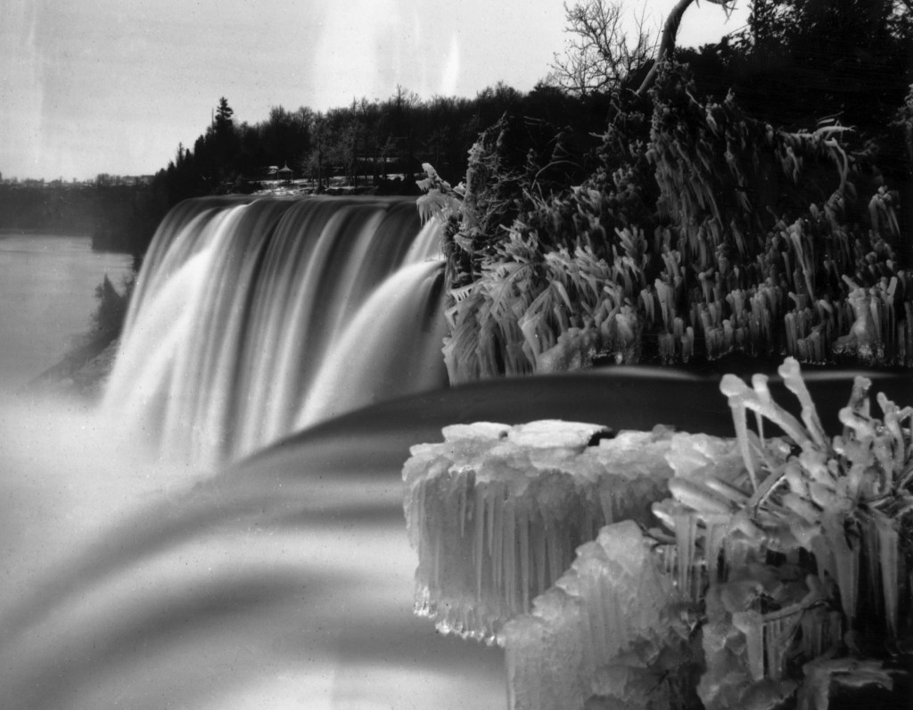 Niagara Falls in winter, seen from Goat Island. Luna Island stands in the middle of the cascade, known as the American or Rainbow Falls, and Prospect Point can be seen in the background, circa 1859. William England/London Stereoscopic Company/Getty Images