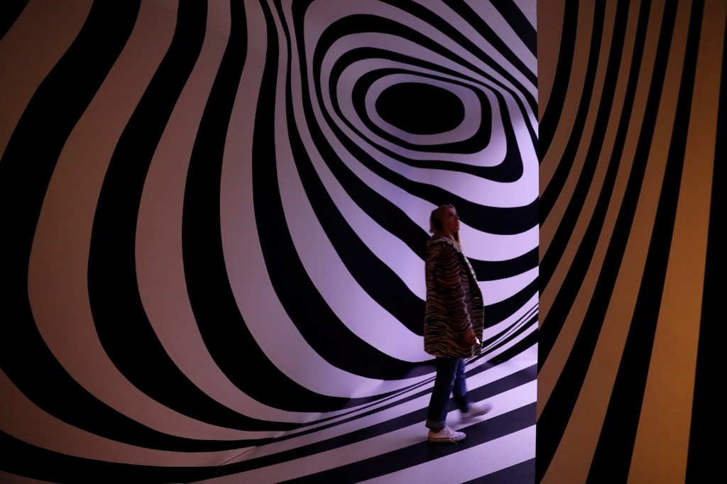 A visitor enters The Pink Floyd Exhibition: 'Their Mortal Remains' at the V&A Museum in London. REUTERS/Stefan Wermuth