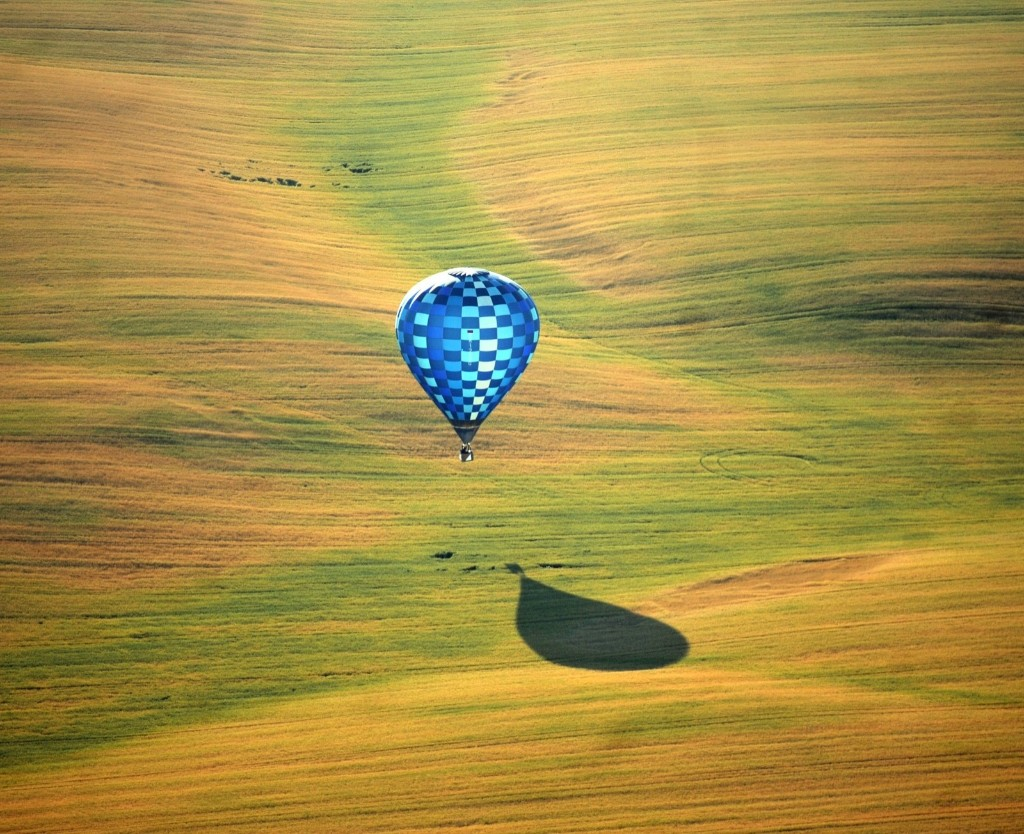 A hot-air balloon flies over fields near Minsk during the Second International Aeronautics Championship. SERGEI GAPON/AFP/Getty Images