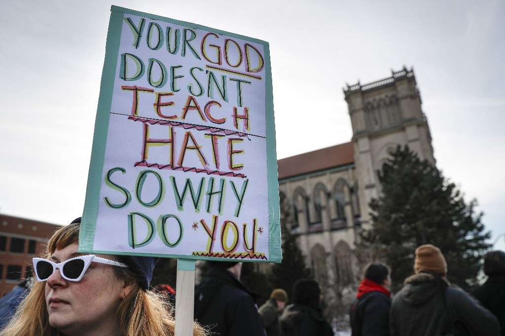 Protestors gather outside the Catholic Diocese of Covington Tuesday, Jan. 22, 2019, in Covington, Ky. The diocese in Kentucky has apologized after videos emerged showing students from Covington Catholic High School mocking Native Americans outside the Lincoln Memorial on Friday after a rally in Washington. (AP Photo/John Minchillo)