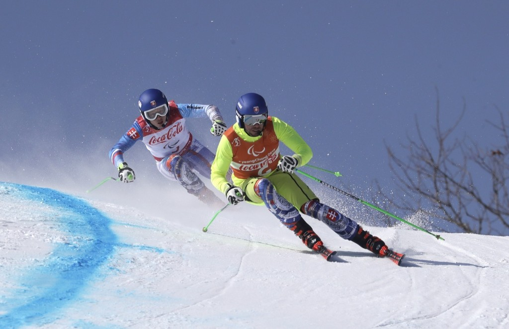 Slovakia's Miroslav Haraus, left, and guide Maros Hudik compete in the men's super-G, visually impaired race. AP Photo/Lee Jin-man