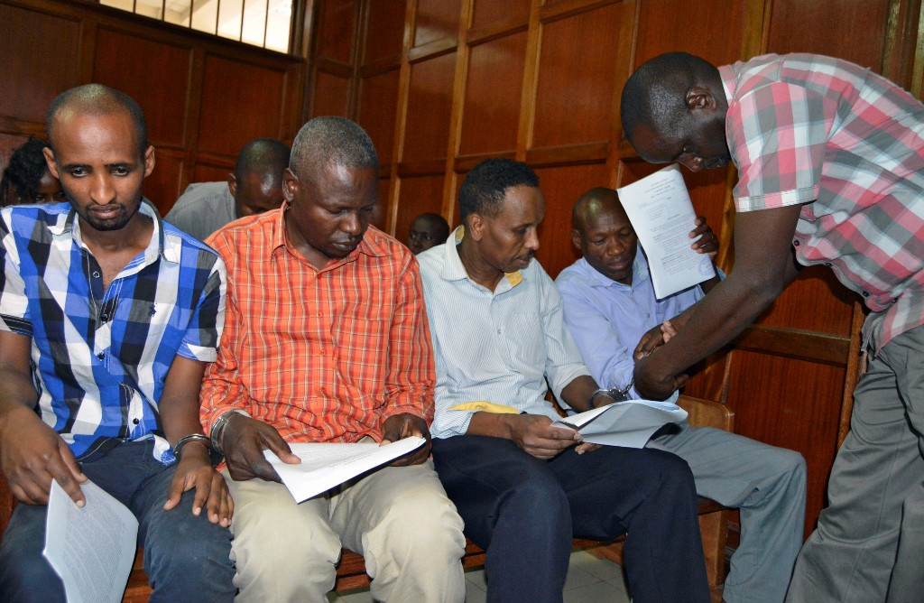 Suspects (L-R) Osman Ibrahim, Oliver Muthee, Guled Abdihakim and Joel Nganga sit inside the Mililani Law Courts where they appeared in connection with the attack at the DusitD2 complex, in Nairobi, Kenya January 18, 2019. REUTERS/Stringer