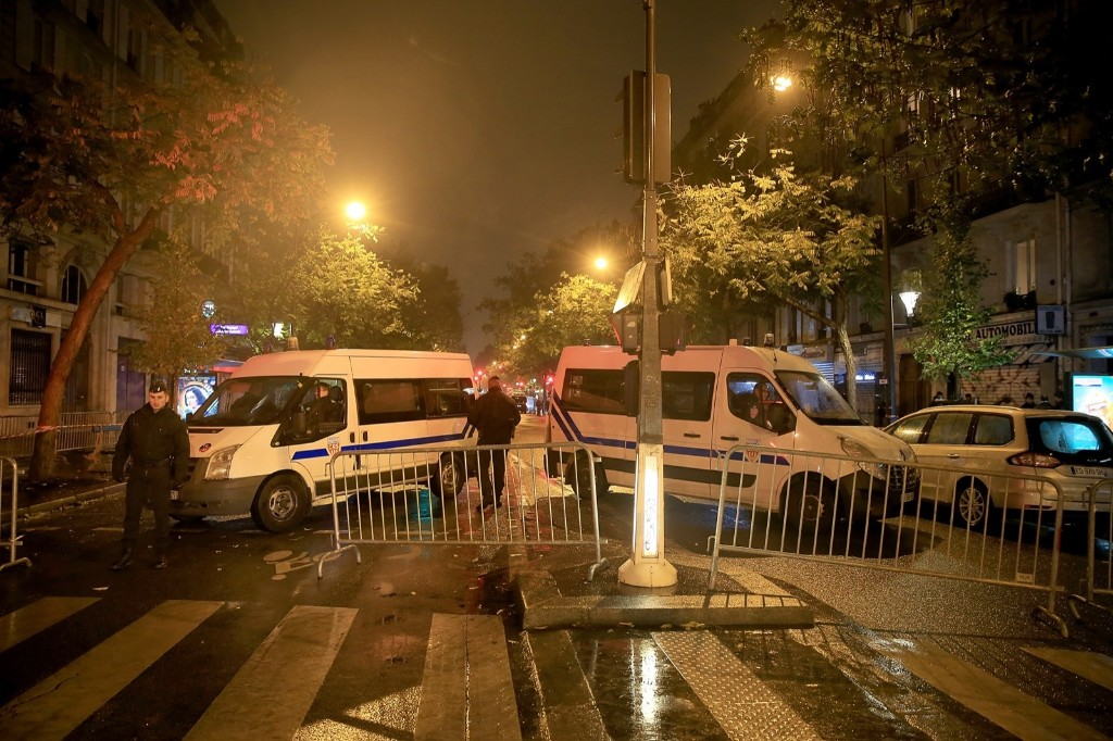 Police cars block the road outside Le Bataclan Concert Hall. Pierre Suu/Getty Images