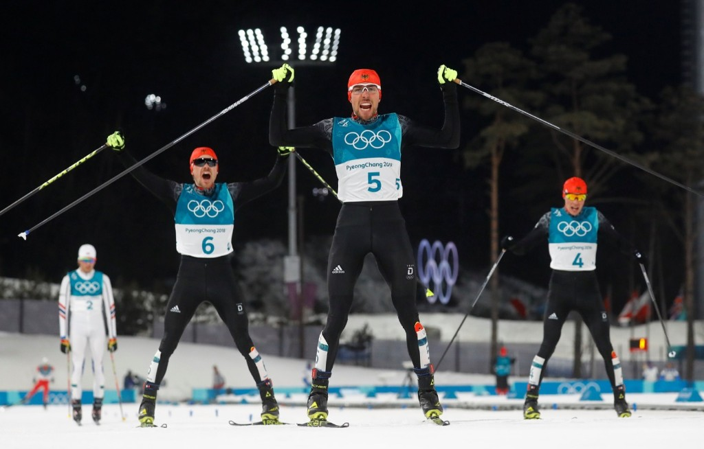 Gold medalist Johannes Rydzek of Germany, silver medalist Fabian Riessle of Germany and bronze medalist Eric Frenzel of Germany as they cross the finish line in men's 10km portion of the nordic combined final. REUTERS/Kai Pfaffenbach