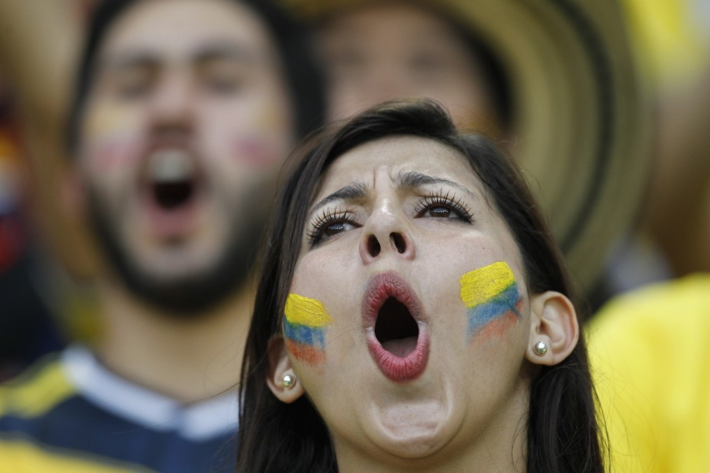 Colombia fan celebrating her side's advance to the quarterfinals where they will face Brazil. Gary Hershorn/Flipboard