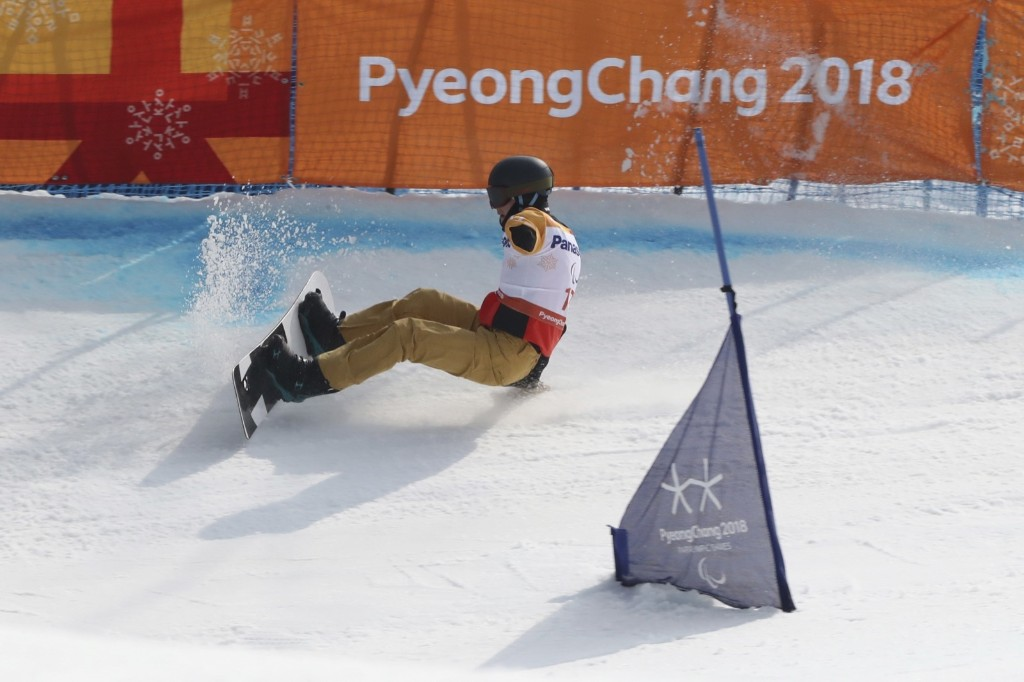 Mikhail Slinkin of Paralympic Athletes of Russia falls during the snowboard event. AP Photo/Ng Han Guan