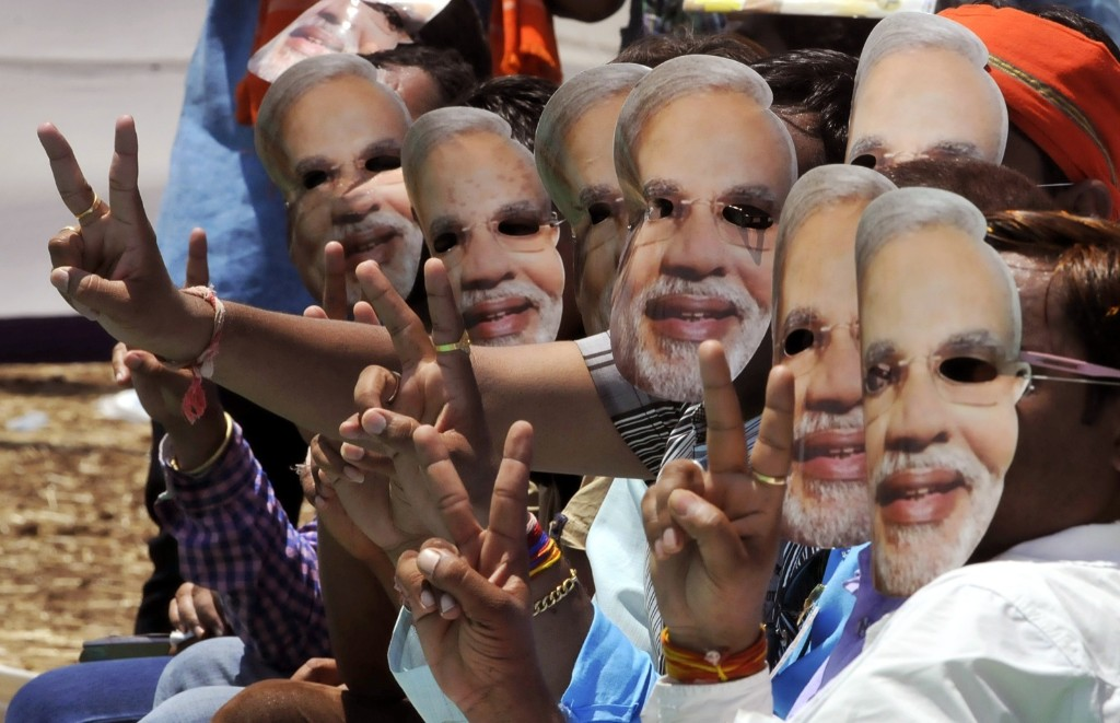 Supporters wearing Modi masks attend an election rally in Dhar, India. Arun Mondhe/Hindustan Times/Getty Images