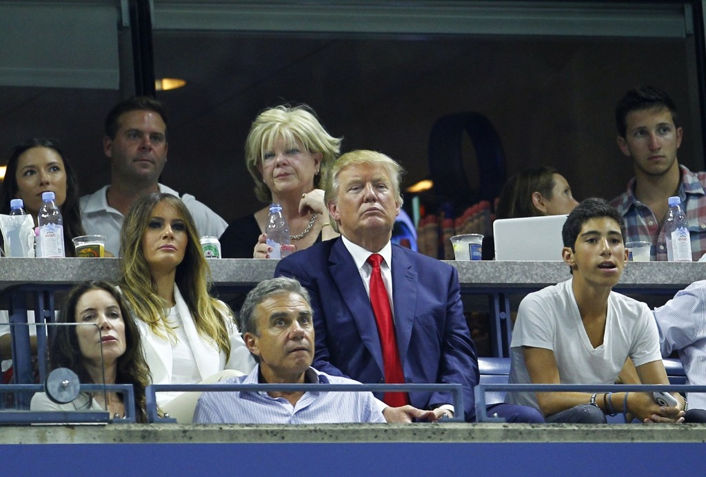 Republican presidential candidate Donald Trump watches Serena Williams of the U.S. play her sister Venus Williams at the U.S. Open tennis tournament in New York, Tuesday. Gary Hershorn/Corbis