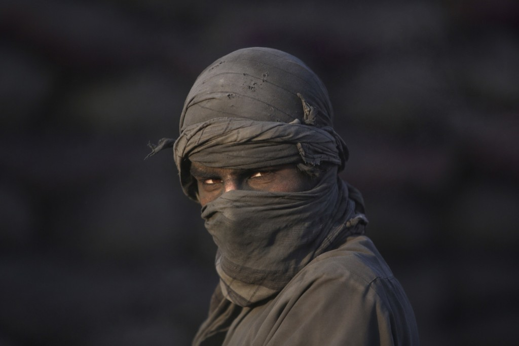 An Afghan laborer at a charcoal shop on the outskirts of Kabul. AP Photo/Rahmat Gul