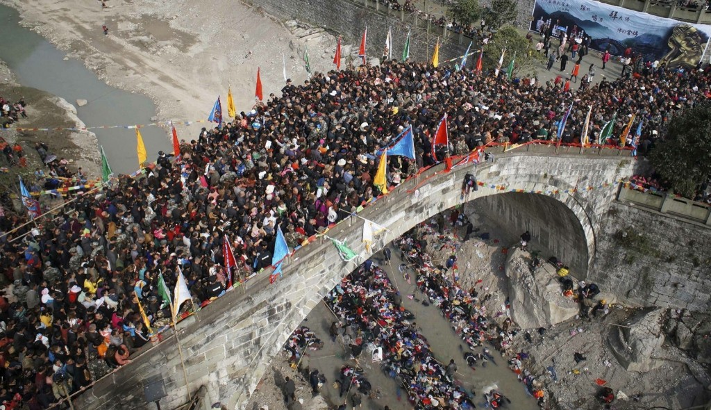 People crowd onto a bridge during the annual Caiqiaohui event in Mianyang, Sichuan province. It is believed that stepping onto the bridge can help them avoid tribulations and illnesses. REUTERS/Stringer