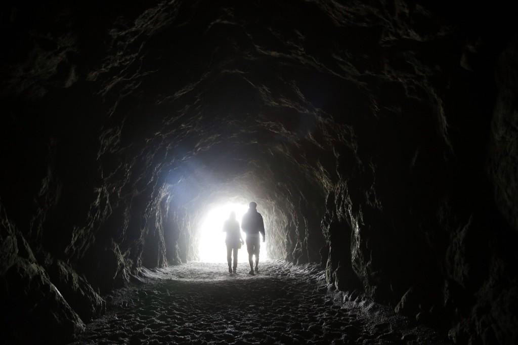 Visitors walk inside a tunnel at Sutro Baths, a popular tourist spot in San Francisco. AP Photo/Marcio Jose Sanchez