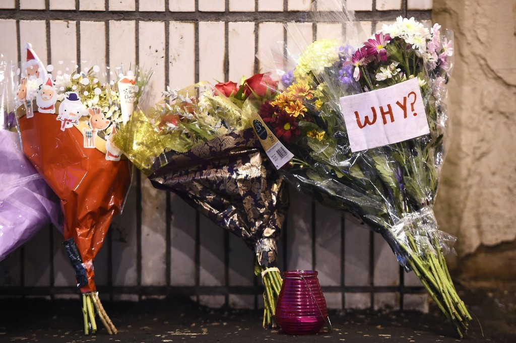 Floral tributes are placed near the scene of the bin lorry crash Glasgow. Six people were killed and eight injured after a bin lorry careered out of control. Jeff J Mitchell/Getty Images