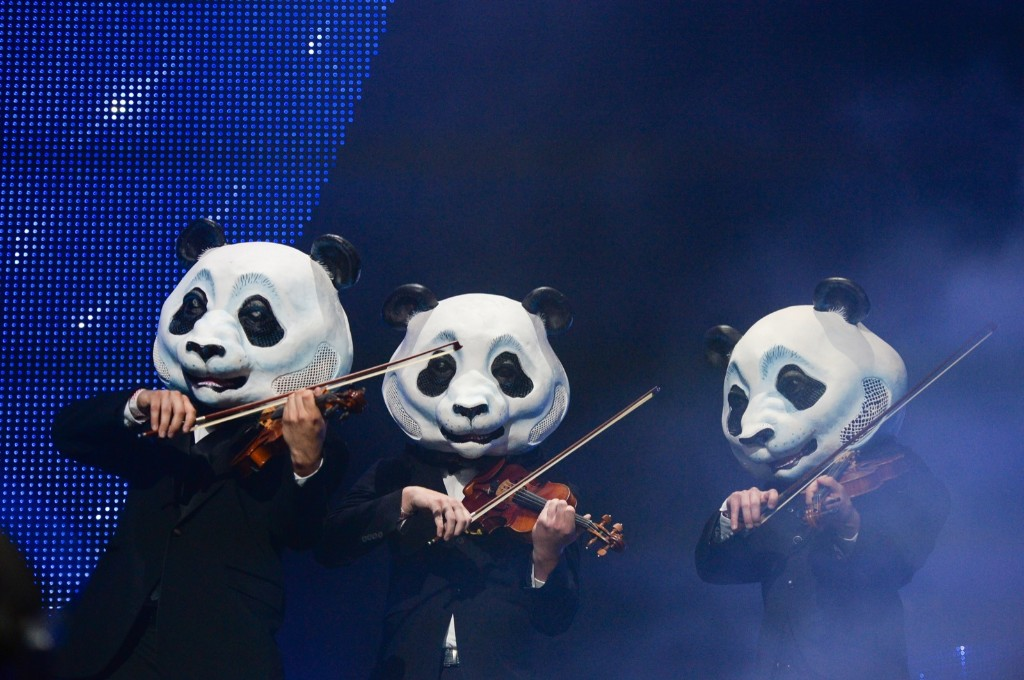 A group of pandas perform on stage during Deorro's set on Saturday. Scott Roth/Invision/AP