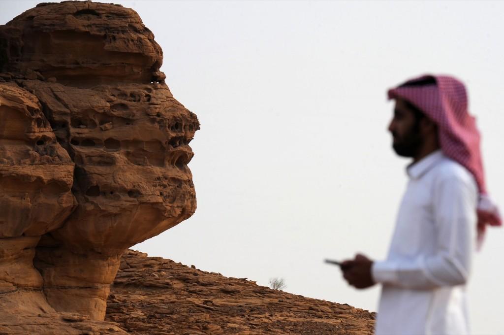 A Saudi man at the Khuraiba archaeological site near Saudi Arabia's northwestern town of al-Ula. FAYEZ NURELDINE/AFP/Getty Images