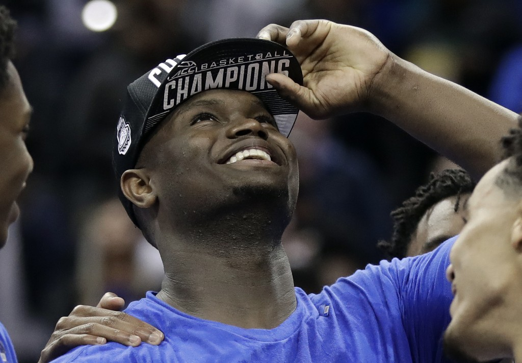 Duke's Zion Williamson celebrates after Duke defeated Florida State in the NCAA college basketball championship game of the Atlantic Coast Conference tournament in Charlotte, N.C., Saturday, March 16, 2019. Williamson was named the tournament's MVP. (AP Photo/Chuck Burton)