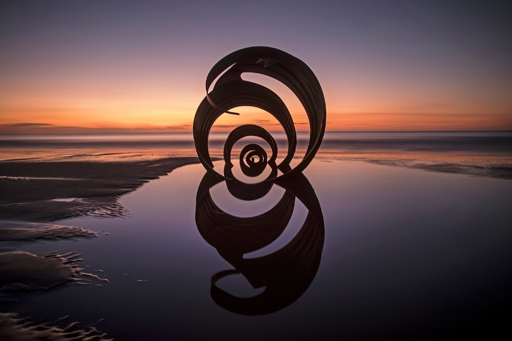 The sun sets behind the semi-submerged Mary's Shell sculpture on Cleveleys Beach in Blackpool, England. Christopher Furlong/Getty Images