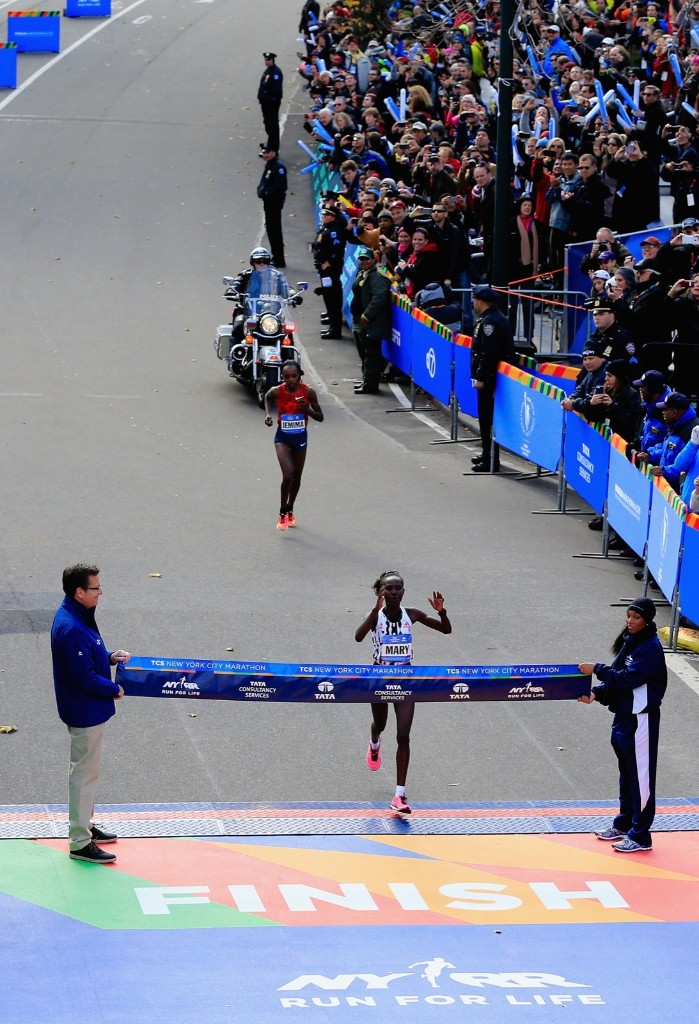 Mary Keitany of Kenya crosses the finish line to win the womens division. Alex Trautwig/Getty Images