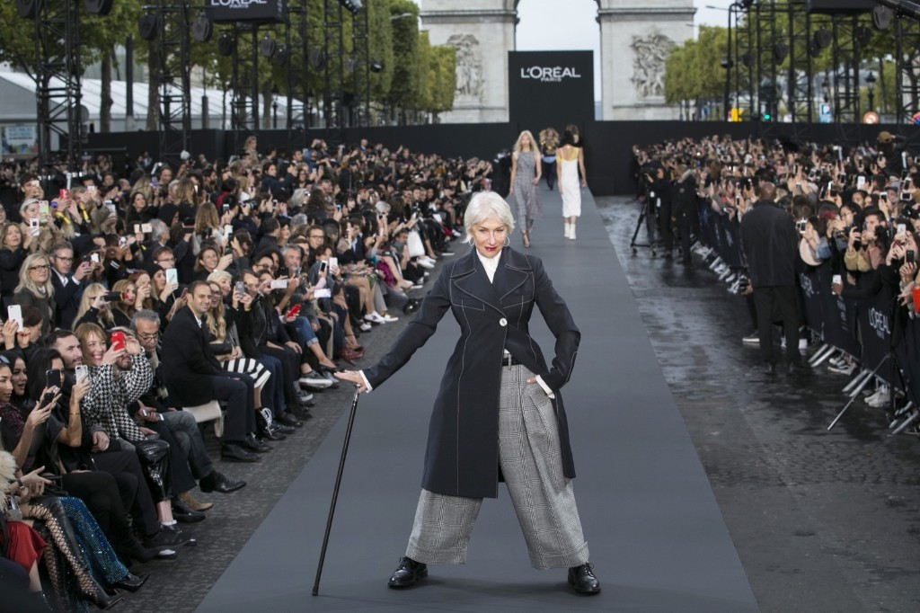 Helen Mirren wears a creation for L'Oreal Spring/Summer 2018 ready-to-wear fashion collection presented during Paris Fashion Week. AP Photo/Kamil Zihnioglu