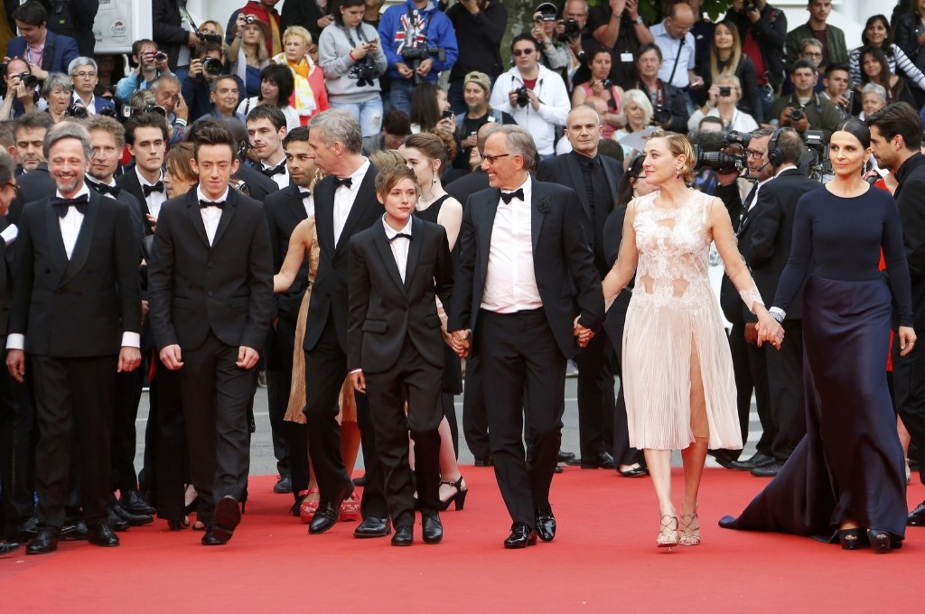 "Director Bruno Dumont (3rdL), cast members Jean-Luc Vincent, Brandon Lavieville, Raph, Fabrice Luchini, Valeria Bruni Tedeschi and Juliette Binoche on the red carpet as they arrive for the screening of the film ""Ma loute"" (Slack Bay). REUTERS/Yves Herman"
