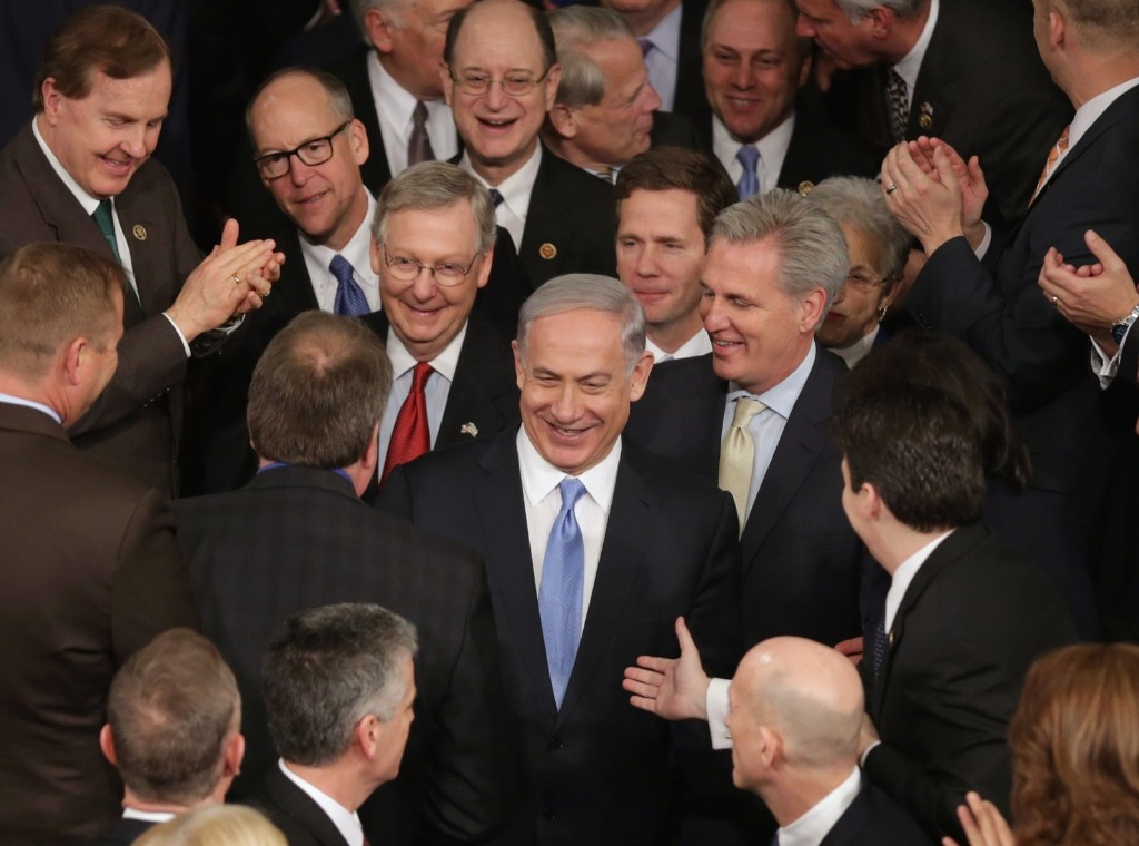 Israeli Prime Minister Benjamin Netanyahu is greeted by members of Congress during a joint meeting of the U.S. Congress, Tuesday, in Washington. Chip Somodevilla/Getty Images