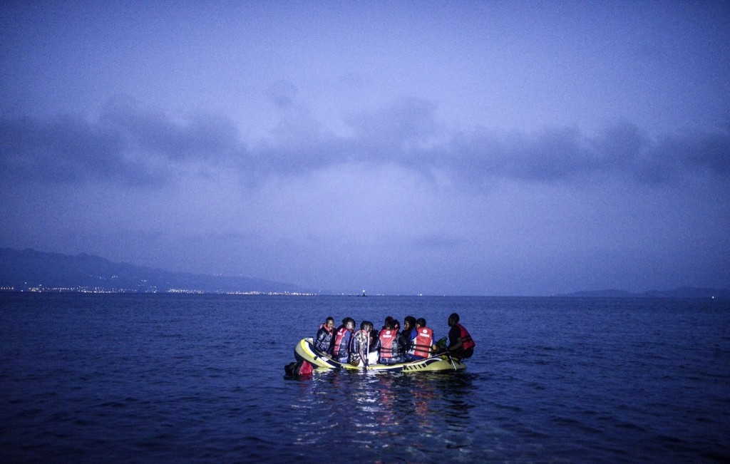 Migrants board a boat to the Greek island of Kos off the shore of Bodrum, southwest Turkey. BULENT KILIC/AFP/Getty Images